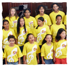 picture of a coral composed by twelve young people dressing a yellow t-shirt of Guri